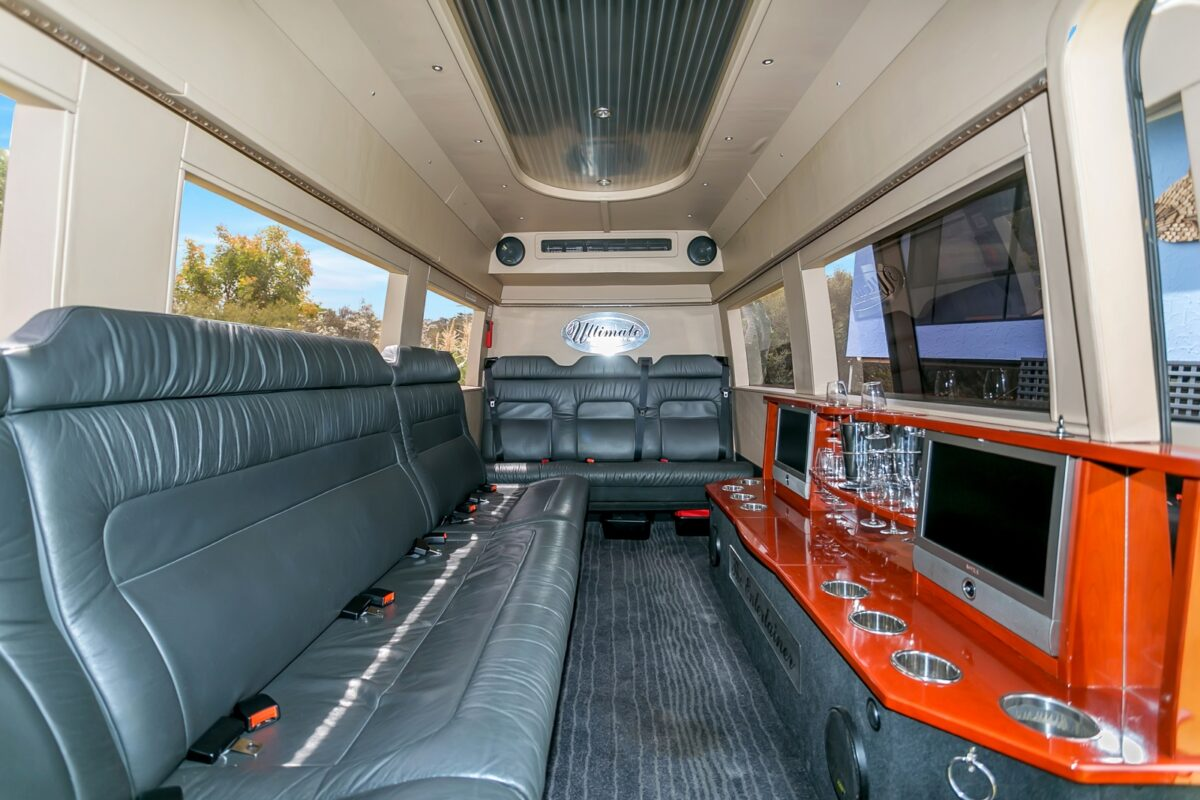 A luxurious Mercedes Sprinter limousine, fully equipped with instant good mood material.